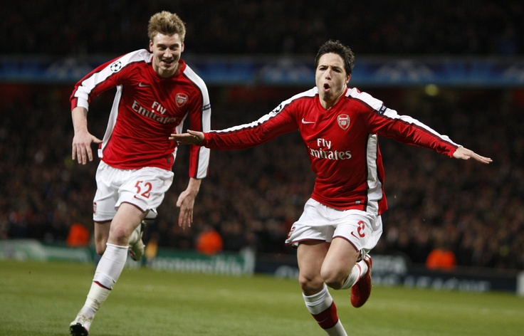 Arsenal's Samir Nasri (R) celebrates his goal against Porto with teammate Nicklas Bendtner during their Champions League last 16, second leg soccer match at Emirates stadium in London March 9, 2010.   REUTERS/Jose Manuel Ribeiro      (BRITAIN - Tags: SPORT SOCCER)
