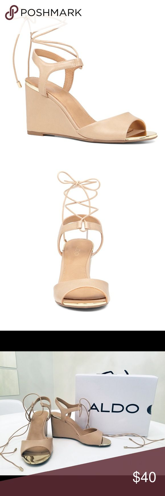 Aldo Beige Wedge Sandals with straps (Frizzell) A stylish cream/beige wedge sandals with straps that tie at the ankle or leg. Metallic finishes add glamour.  Heel height: 3.25 inches.  Worn only once for a wedding and in great condition! Aldo Shoes Wedges