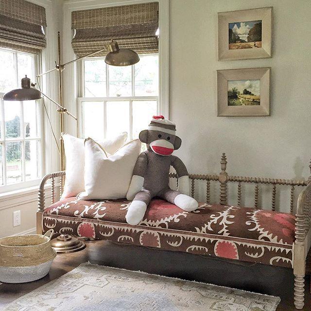 Mela & Roam | Vintage spool daybed upholstered in antique suzani.