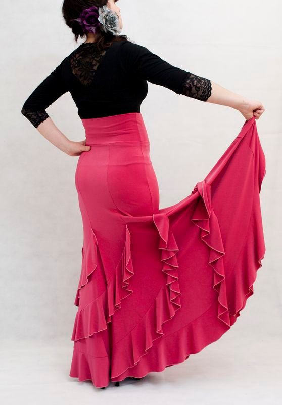 Flamenco Practise Skirt, with a high waist. Fitted at the hips and wide at the bottom. Beautiful garment with spiralling ruffles.  Made from