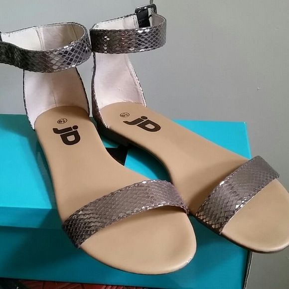 Silver Pewter Sandal AMAZING sandal!! Purchased again a 9. Bought a month ago. Comfortable and they go with everything. Shoes