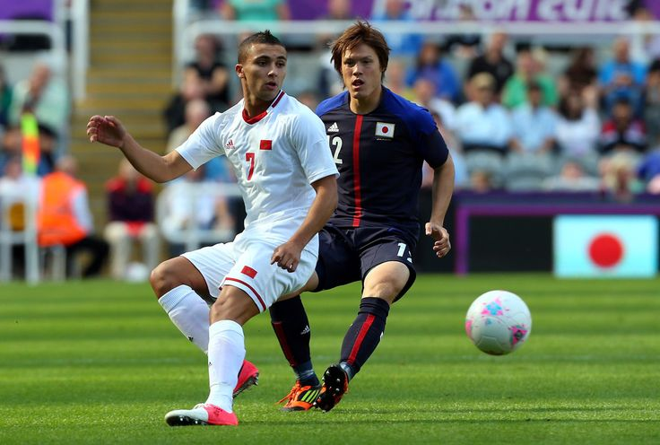 Labyad Zakaria of Morocco holds off Gotoku Sakai of Japan during the Men's Football first round Group D match between Japan and Morocco on Day 2 of the London 2012 Olympic Games at St James' Park on July 29, 2012 in Newcastle upon Tyne, England.
