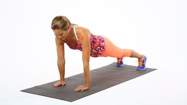 Balance on the hands and toes with the body in one straight line, hands underneath the shoulders and feet h...