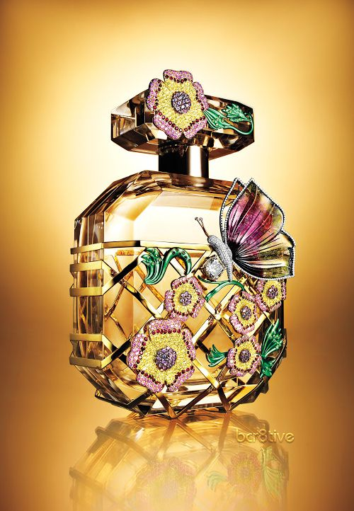Victoria's Secret Bombshell Fantasy Fragrance -- London Jewelers designed the bottle; decked out with yellow  pink diamonds, sapphires, tsavorite, rubies  a hand-carved butterfly, whose body is made from a 10 carat white diamond....