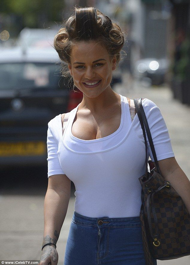 Chirpy: Chantelle seemed in good spirits as she beamed on her journey home...