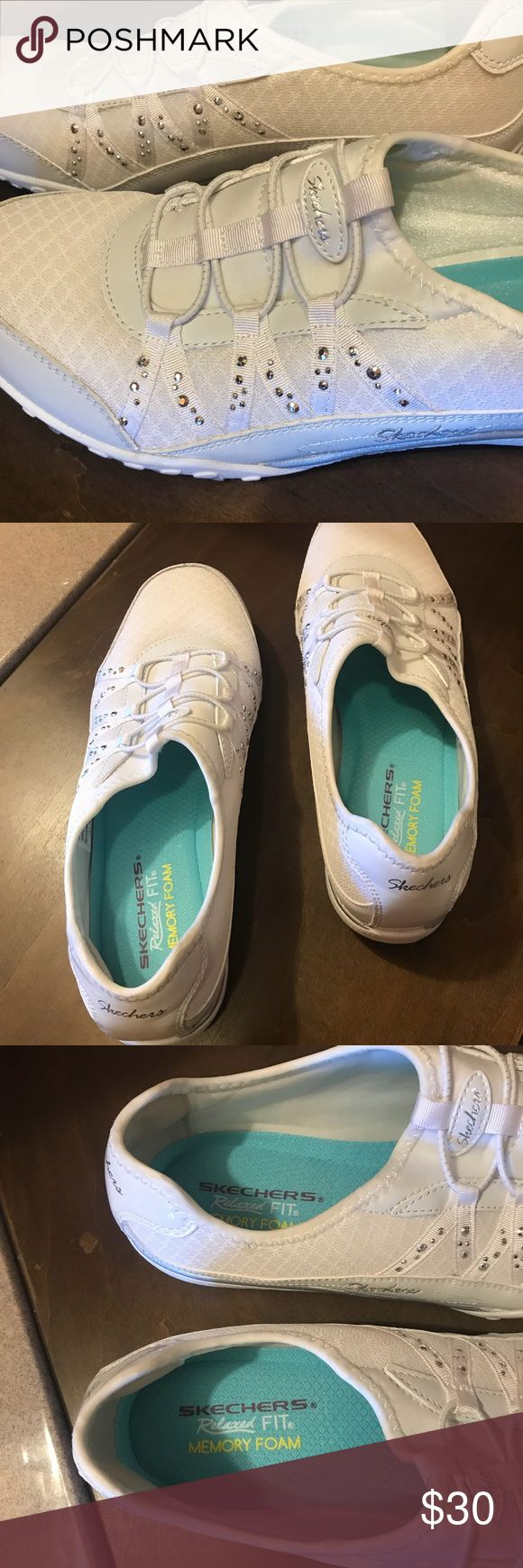 Skechers memory foam slip on tennis shoes size 9 Skechers memory foam tennis shoes - size 9 - slip on- only worn once - White with rhinestones Skechers Shoes Athletic Shoes