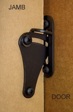Sliding Barn Door locking latch to ensure privacy for bathroom doors. This will keep the door from being pushed to either side when closed. Be sure to leave a few inches of door on each side so noone will catch an unintended glimpse. Don't install latch on the edge of the door.  Also the door needs a notch to open the door from the inside.