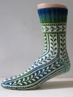Having just wrestled with a multi coloured stranded sock, I wanted to design a pattern that just used two colours throughout. It's a very simple little leaf chart, and in the course of the sock, it will get modified in three different ways: on the heel, it disappears into stripes without decreases, over the instep it decreases centrally, and on the toe it gets decreased from the outside in. Not that that's important, the little geek inside just wanted to point it out…
