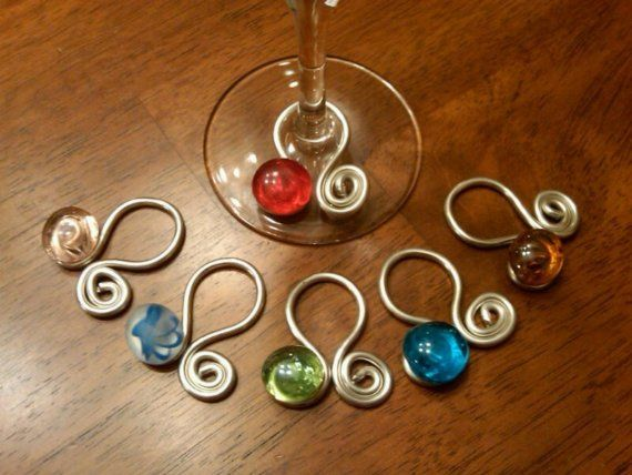 Also a cute idea. (Doesn't link to a tutorial, but seems easy enough. Wire, pliers, beads, hot glue...)