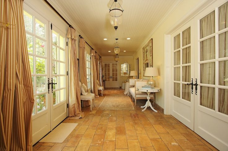 Traditional Porch with 19th c. british colonial urn lantern, Screened porch, French doors, exterior stone floors