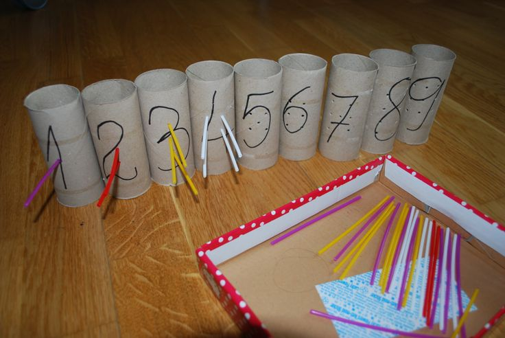 Numbers activity - putting sticks into holes (for an increased difficulty make them go through the other way)