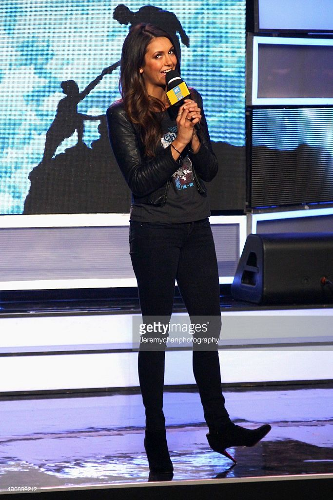Actress Nina Dobrev speaks during WE Day Toronto at the Air Canada Centre on October 1, 2015 in Toronto, Canada.