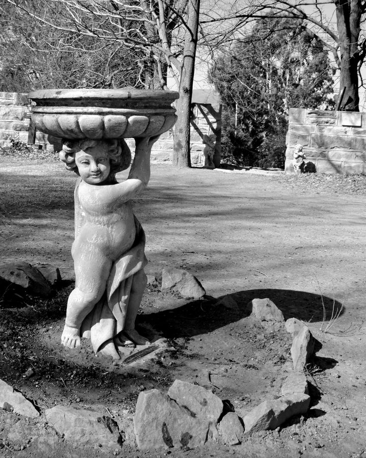 Cherubic birdbath at The Little Church, Van Reenen's Pass by Rosemary Hall #Black&White http://www.n3gateway.com/n3blog/80/Serenity-coupled-with-the-smell-of-candle-wax-in-the-Little-Church.htm