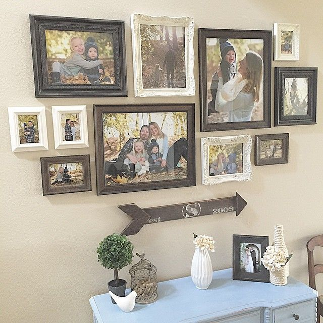 "Are you guys sick of this wall?  I hope not because it's my favorite!  I'm sharing it for #projectvignette.  I display our family photos here in the miss matched frames.  I made the arrow which has an ""S"" on it to represent our last name, and the year 2009, which is when my husband and I got married.  The desk below is my favorite piece I've painted.  For all of these reasons, this spot is special to me"