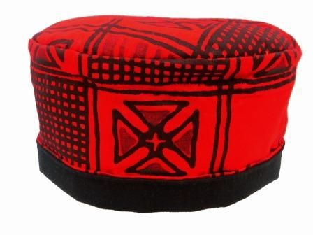 Stand out in this fully reversible pill box hat in a cotton fabric with an unusual design and striking colour. Handmade with a lightly padded crown and a full black reversible inner.