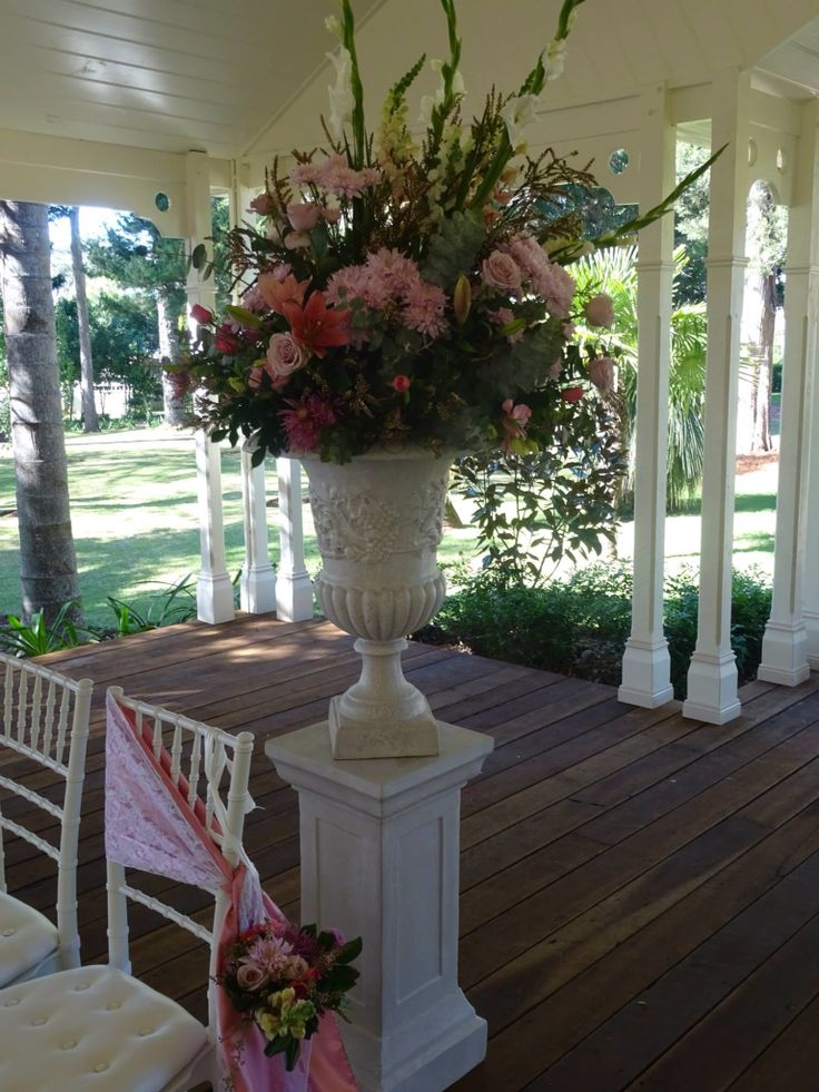 Traditional Columns and Urns for a vintage wedding. Pink florals