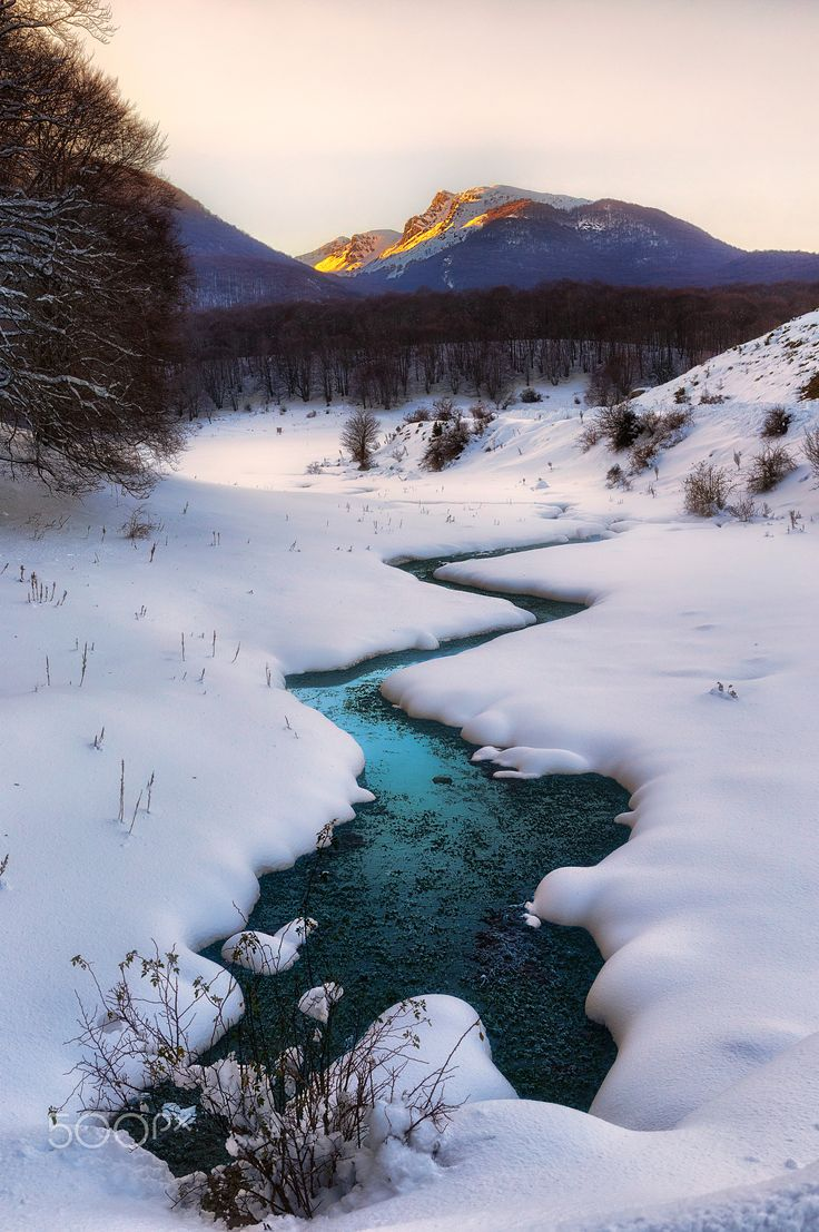 Scenic view of a river in winter - Scenic view of a river in winter