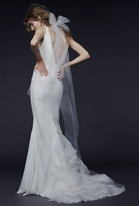 "Brides.com: . ""This Vera Wang gown reminds me of the now-iconic dress that Carolyn Bessette wore to marry John F. Kennedy Jr. in 1996 — proving that a sleek and elegant silhouette will never go out of style!"" — Michela Hattabaugh, Wedding Style Assistant   Wedding dress by Vera Wang"