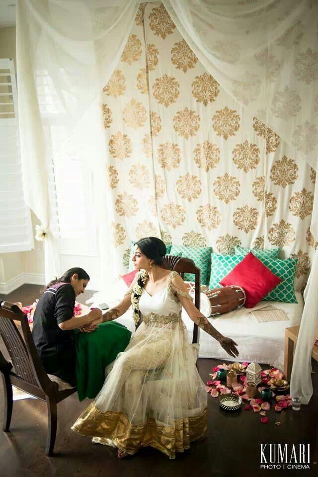 Mehendi function. Bride in white anarkali and jasmine flowered braid