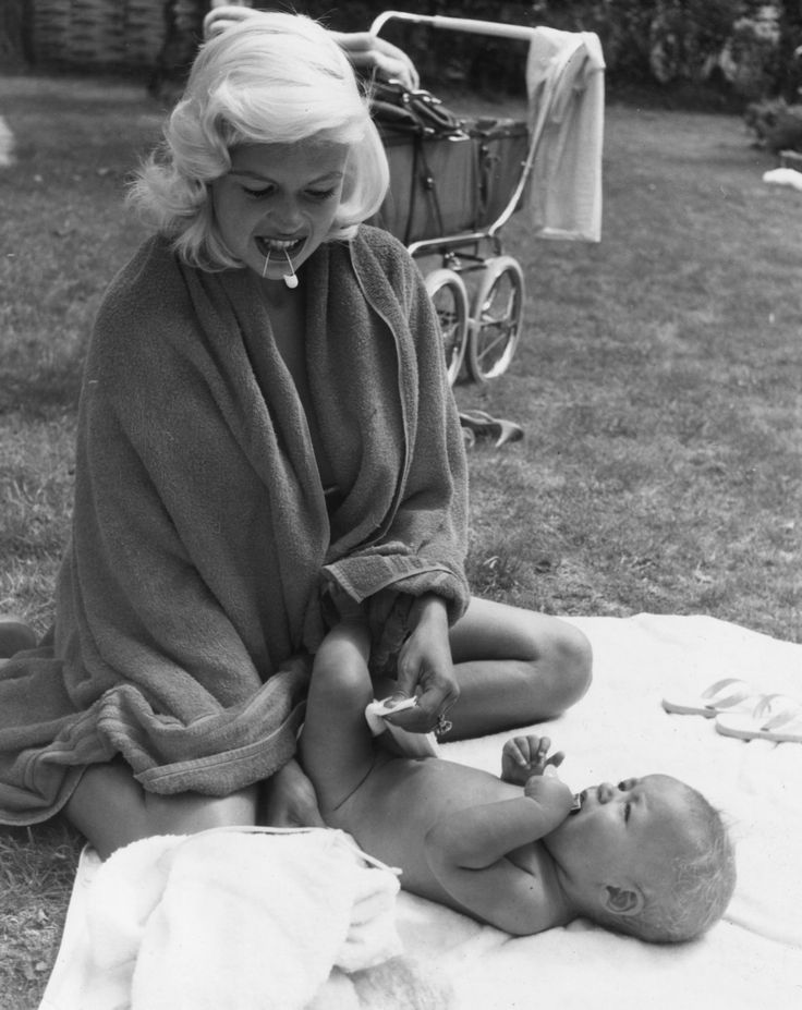 Jayne Mansfield changing her son's diaper.