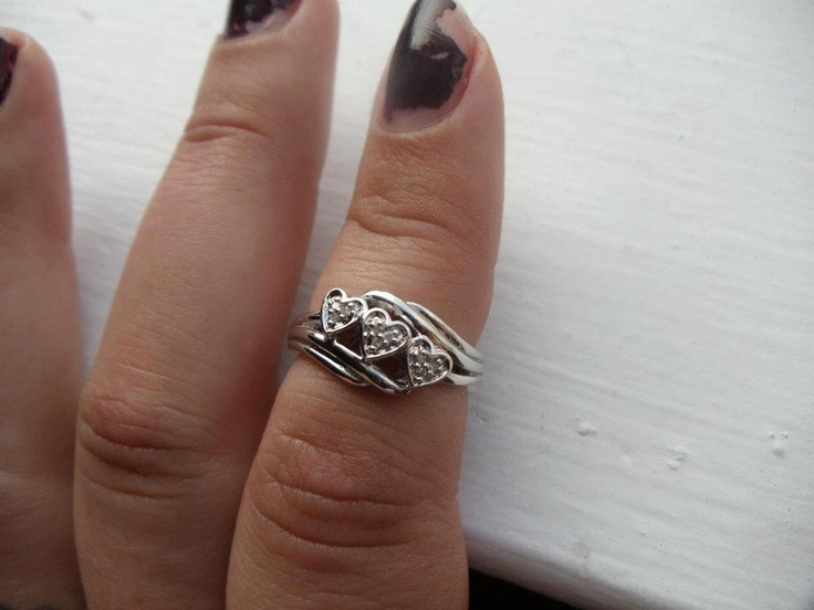 A silver triple heart ring from a Diamond Candle worth over $100. It may be in a smaller size in this instance, but you can find rings of many different sizes in our candles. You can also get any ring worth $100 or more re-sized at your local jeweler.