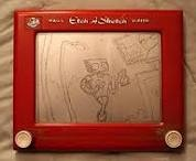 The Etch-A-Sketch.  This was fun, but I preferred the permanence of drawing on real paper.