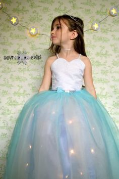 19 DIY Kids' Halloween Costumes That Are So Cute You'll Want to Cry: LIGHT UP BALL GOWN. Your daughter will lose her little Girl Meets World-addled mind over this high-tech skirt, which can be used for anything from a fairy princess to a rock star to a...girl in the coolest dress anyone's ever seen. It just takes a dress or skirt with a tulle bottom (check your thrift store if you don't have one) and battery-operated packs of Christmas lights. See more at So Sew Easy.