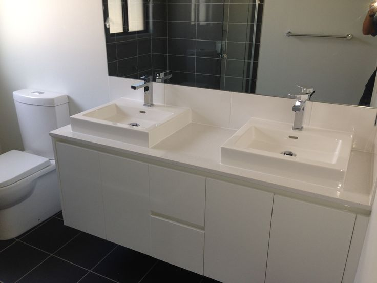 Ensuite vanity unit by INZ Kitchens with finger pulls in lieu of handles. Kado Lux above counter basin's and Mizu Bloc mixer taps. Home completed by Better Built Homes December 2015