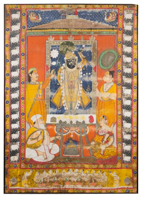 A Large Indian Painting 18th/19th century depicting a central deity standing wearing long rob