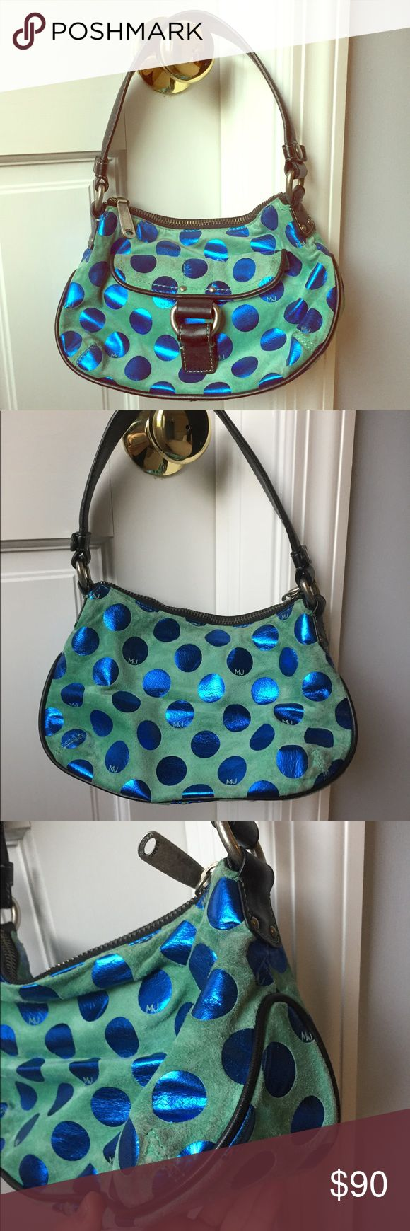 Marc Jacobs green and blue polka dot handbag Authentic Marc Jacobs Bag is covered mostly in green suede with royal blue metallic polkadots with the initials MJ. The bag is outlined in navy blue leather, shoulder straps are also navy blue leather. Silvertone hardware with Marc Jacobs. Bag has some sign of usage but overall it is in fantastic condition, it is a very nice and rare handbag. Some cleaning will make it just perfect.  Will include the original duster bag. Marc Jacobs Bags Shoulder…