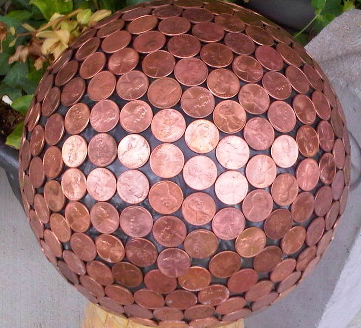 Bowling Ball Yard Art- Pennies in the garden repel slugs and make hydrangeas blue.  For the glue-Amazing Goop Home and Garden or Marine formula, because they are UV resistant as well as waterproof.