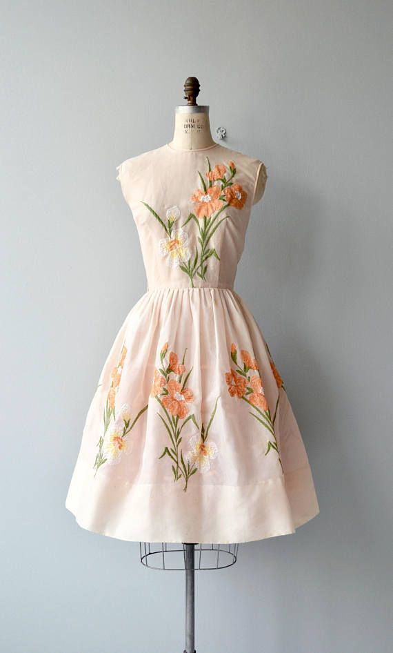 Vintage 1950s, early 1960s pale peach cotton voile dress with pastel embroidered flowers at the bodice and all the way around the skirt, fitted waist, full skirt and metal back zipper. --- M E A S U R E M E N T S --- fits like: medium bust: 40 waist: 29 hip: free length: 42 brand/maker: Mr. Henry condition: excellent to ensure a good fit, please read the sizing guide: http://www.etsy.com/shop/DearGolden/policy ✩ layaway is available for this item ✩ more vinta...