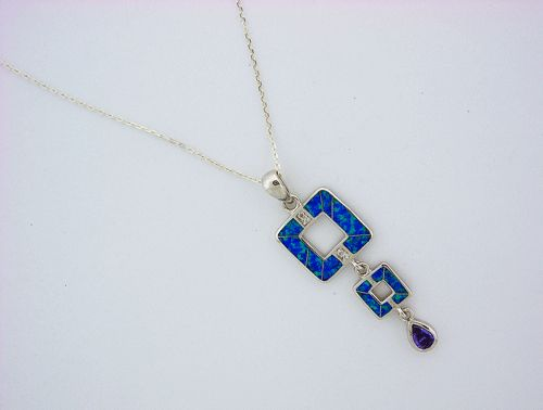 This is a beautiful Sterling Silver Blue Opal and Purple Amethyst Pendant with a 925 sterling silver chain.