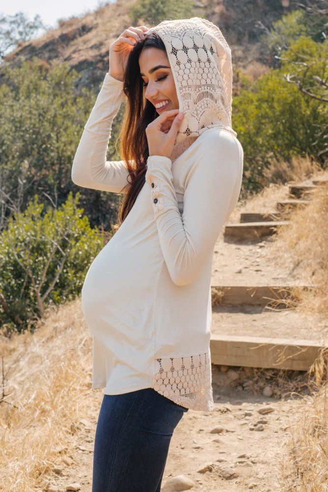 Fall in love with the soft material, flattering design, and romantic touches of this crochet accent hooded maternity top. Wherever you're heading this cool weather season, this top has it all for comfort and style.