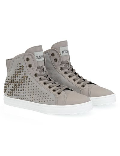 #HOGANREBEL R182 High-top #sneaker in #suede with leather and patent leather details, visible stitching and side machining characterized with metal #studs  effect. With small wedge invisible inside. A shoe of #rock appeal. Discover more here hoganrebel.com/women