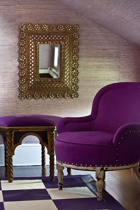 Purple chair and ottoman. Different furniture pieces brought together by common upholstery. Silver textured wall and gold mirror make for a great pair, too.