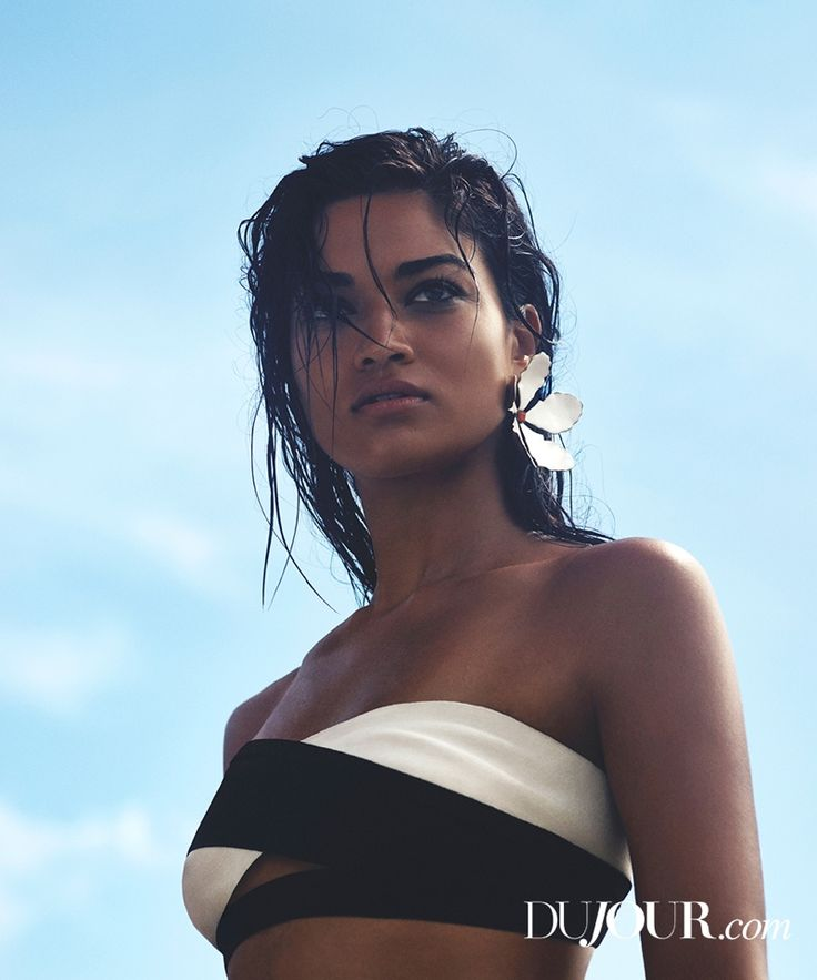 Shanina sports the wet hair look in an Herve Leger swimsuit