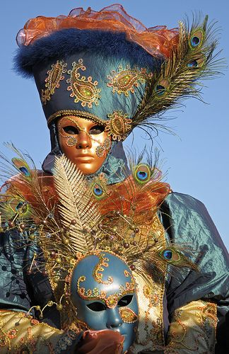 Beautiful costume with hand mask.