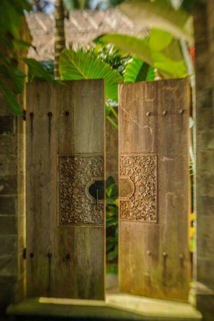 Villa entrance with large carved wooden doors. Those larges leaves too!