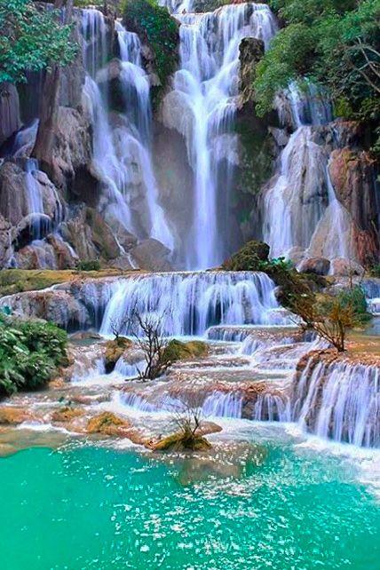 Cool off in the otherworldy Kuang Si Falls just south of Luang Prabang. #Laos #LiveIntrepid