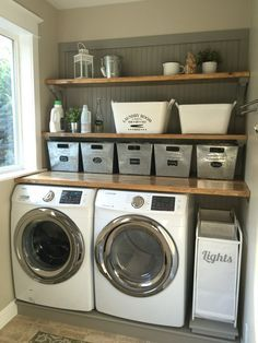 Laundry room makeover. Wood counters, Walmart tin totes, pull out laundry bins. #laundryroommakeover shelf above washer dryer Mudroom