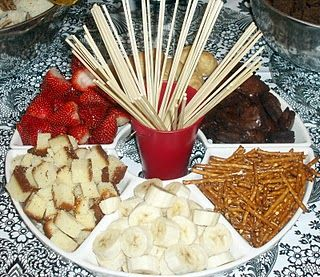 I need more ideas for a fun fondue tray for fondue night tomorrow! I'm thinking everything here looks good- but we might need more fruits than this....