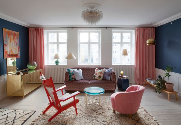 Designed by Tina Seidenfaden Busck, this living room combines vibrant colours and metallic finishes to dramatic effect.