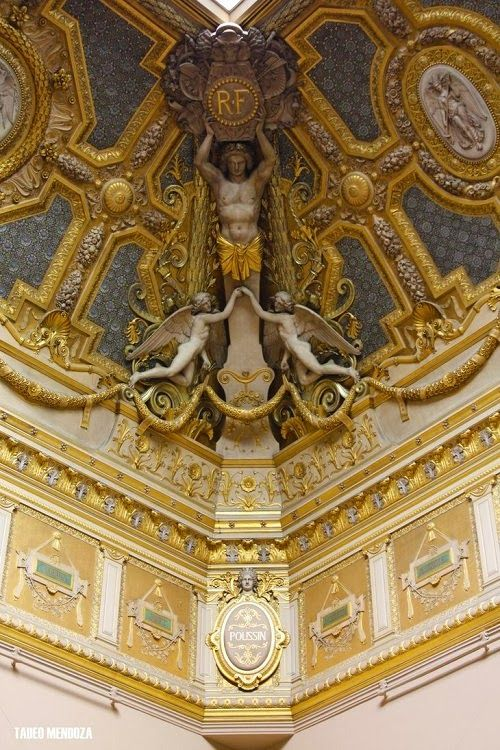 Ceiling detail in a room in the Louvre Museum, Paris, France. The Louvre is one of the world's largest museums and a historic monument in Paris, France. A central landmark of the city, it is located on the Right Bank of the Seine in the 1st arrondissement.
