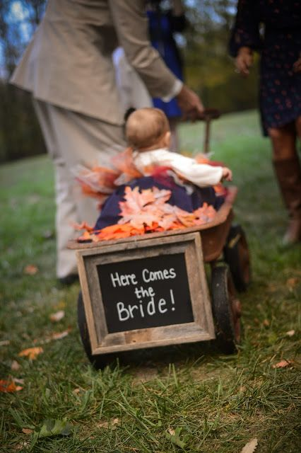 Here comes the bride | flower girl in wagon