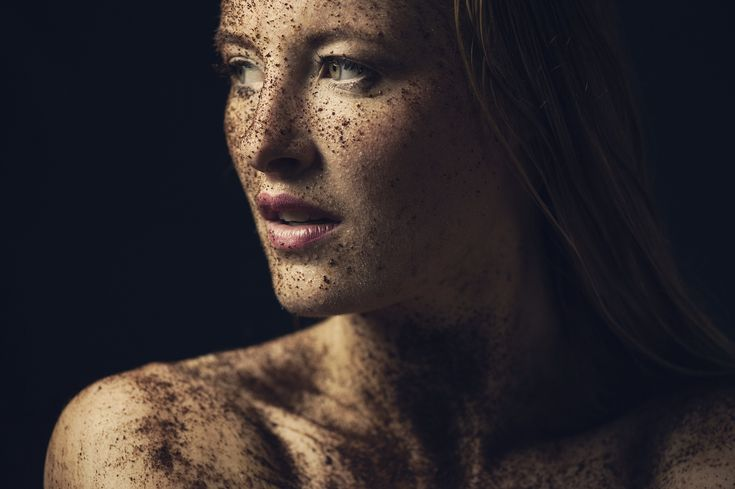 Portrait of young woman with sand in her face