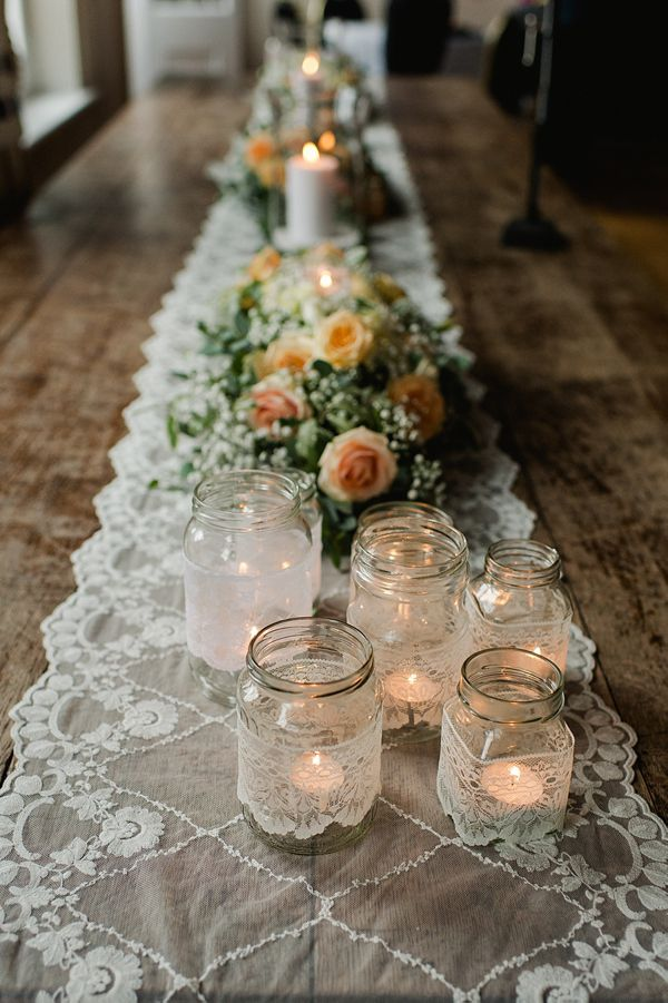 Lace table runner/table cloth and glass jars with tea lights and lace.  From 'A Suzanne Neville Gown, Red Lips And Touch Of Old Hollywood Glamour.'  http://www.alexa-loy.com/
