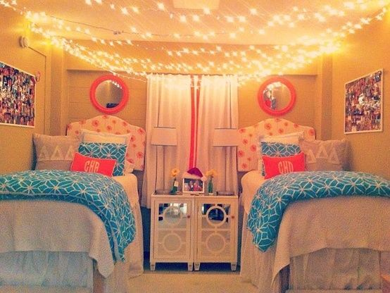 dorm room hanging string lights across ceiling pink and