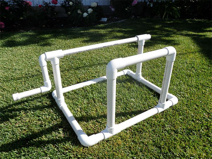 PVC Pool Cover Roller - no instructions but you can clearly see how it's done. The roller bit is just smaller size pvc pipe slid through larger gauge T couplings  so when you turn the handle it spins. Why buy when you can make?