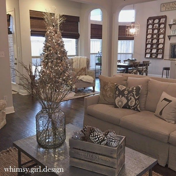 whimsy girl: Holiday House Walk {Part 1}: Linen couch, metal coffee table, flocked tree, pinecones in crate, plate rack, reading nook, nuetral living room.